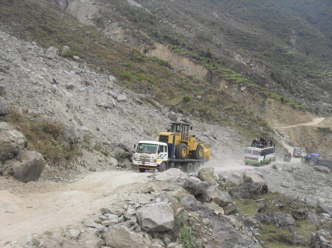 Dozer transported by Nepalese truck