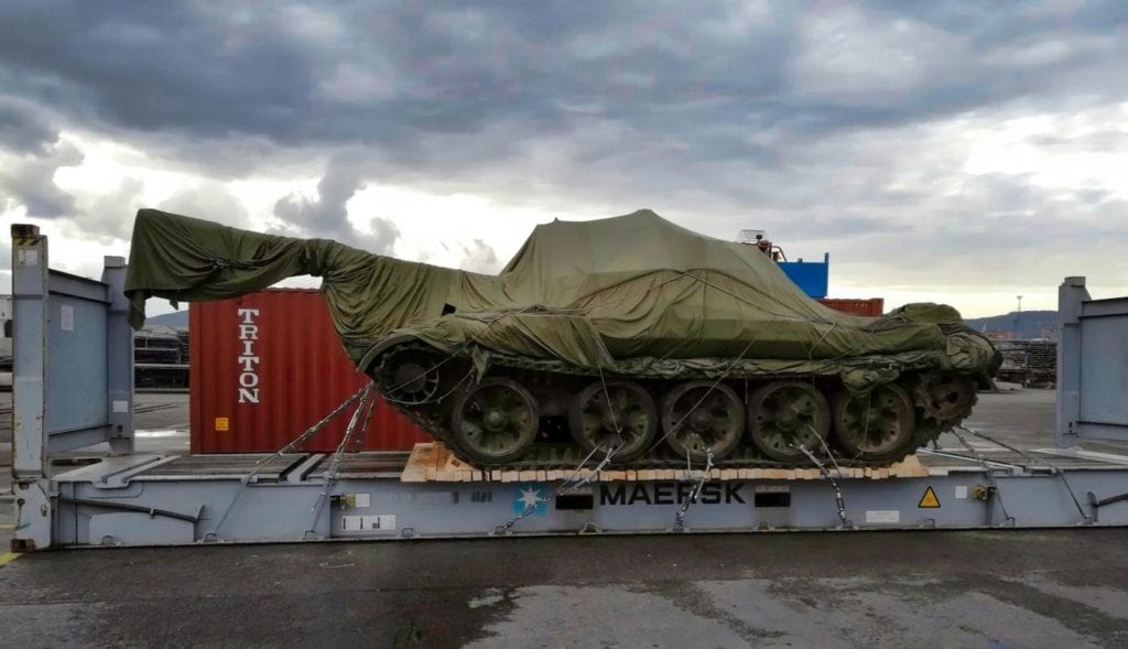 Military Tank loaded on a flat rack