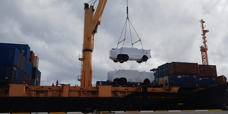 Crane lifting a large vehicle